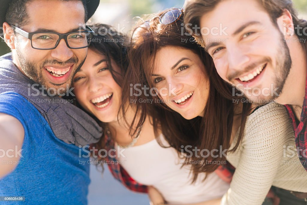 Group of fiends taking a selfie in Barcelona. stock photo