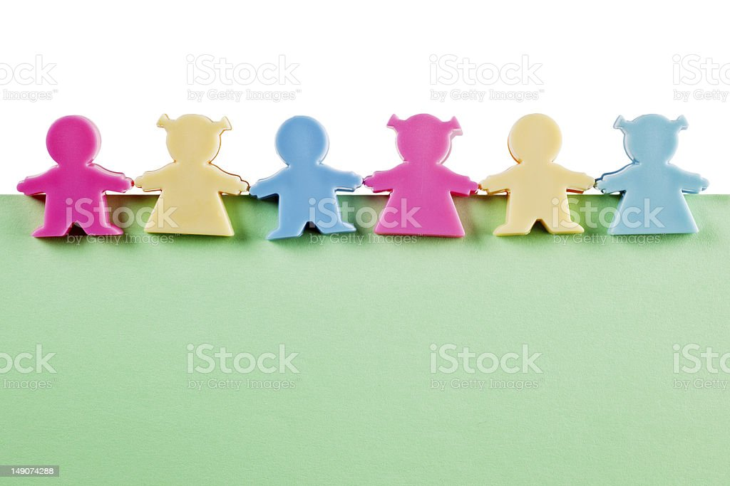 Group of figurines on blank paper royalty-free stock photo