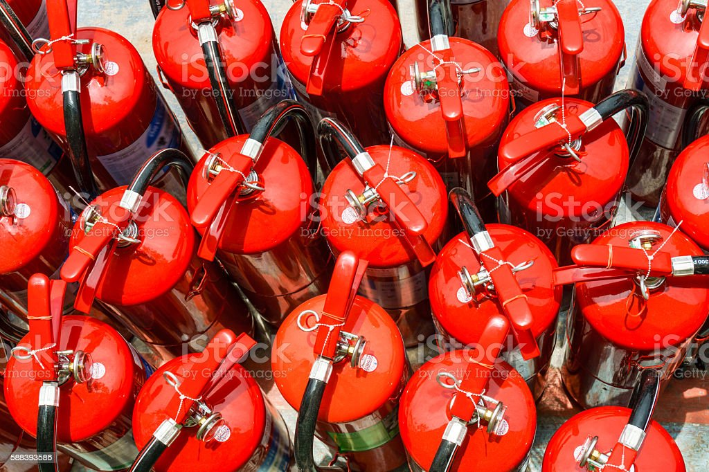 Group of fire extinguishers stock photo