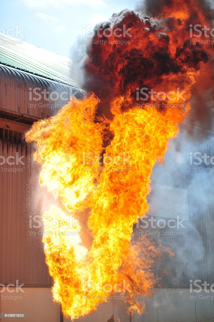 group of firefighters man are inject spray the water to fire accident on building stock photo