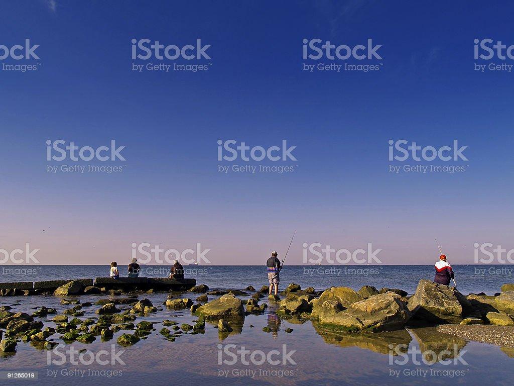 group of fishermen on the coast royalty-free stock photo