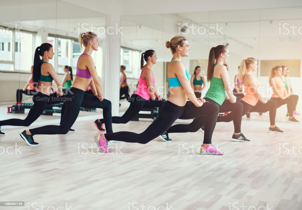 Group of fit and healthy women exercising stock photo