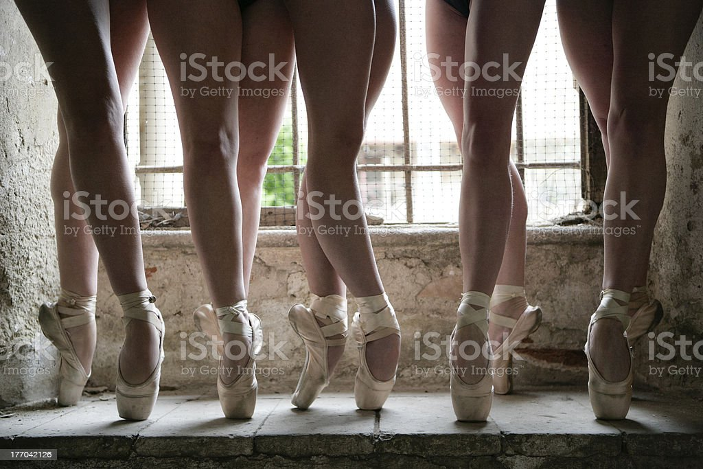 Group of five dancers legs shooted together on pointe royalty-free stock photo