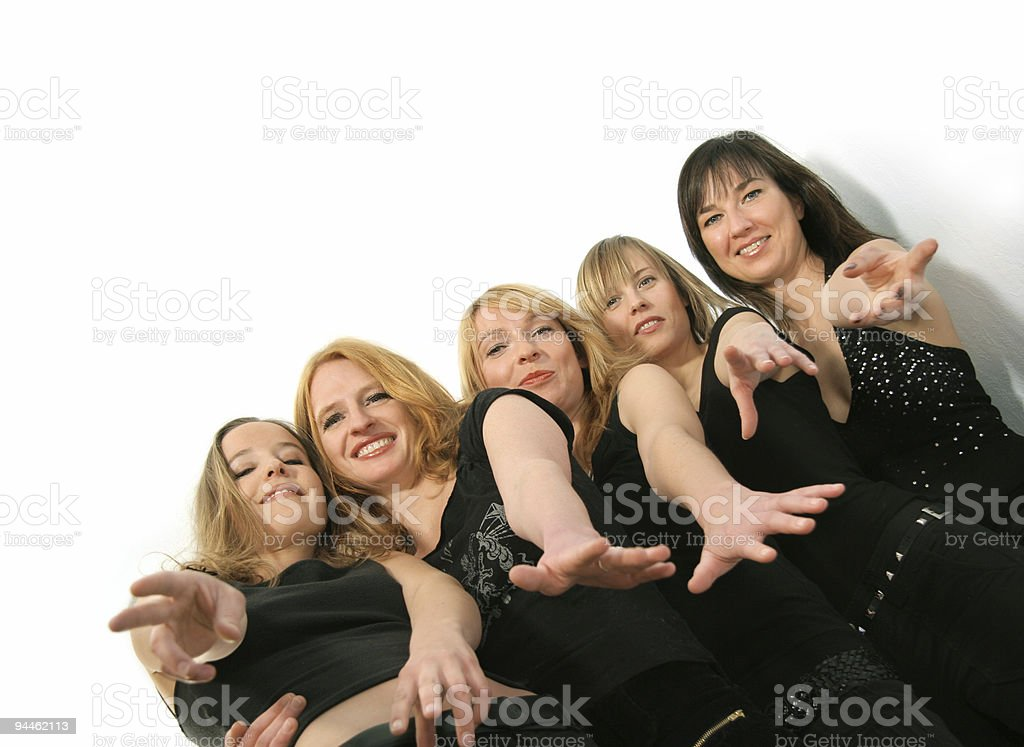 Group of five girls trying to catch you royalty-free stock photo
