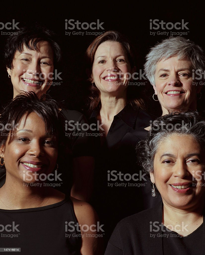 Group of five women smiling, portrait stock photo