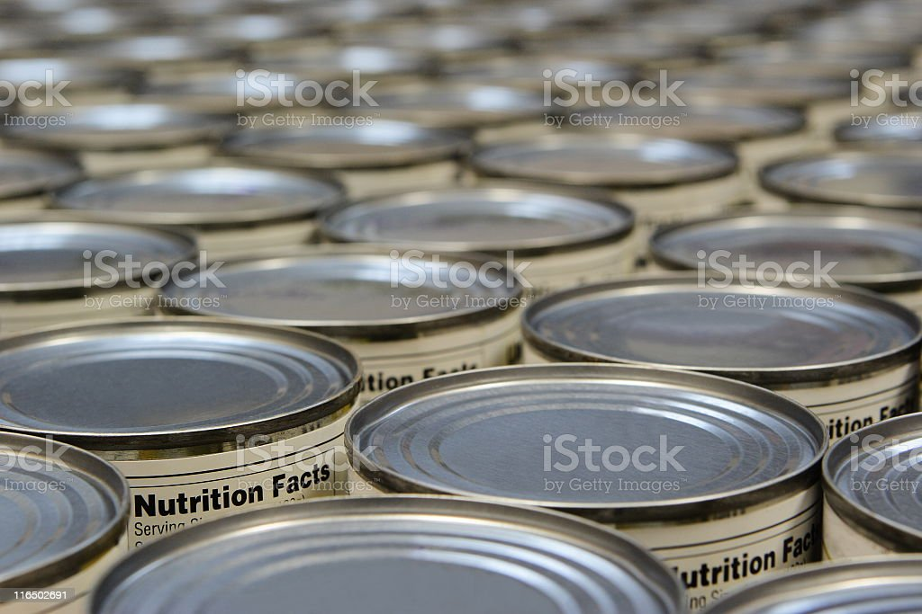 A group of food cans with the nutrition fact label showing stock photo