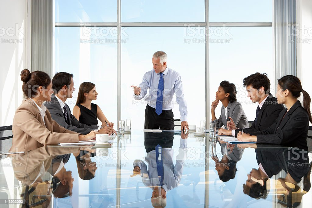 Group of formal business people having a board meeting royalty-free stock photo