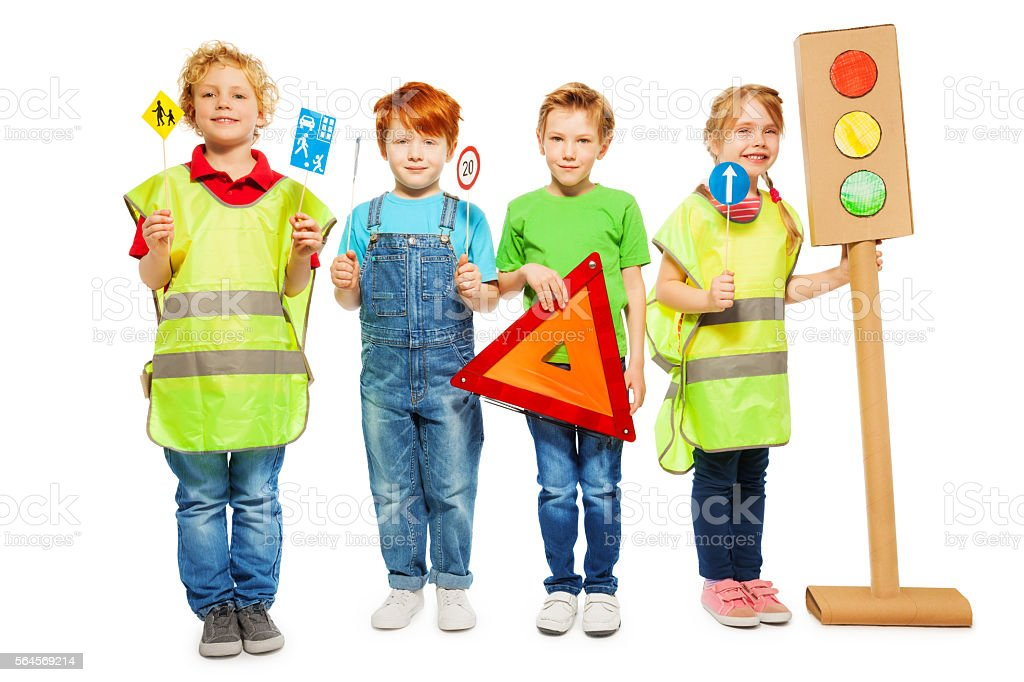 Group of four kids studying road safety rules stock photo