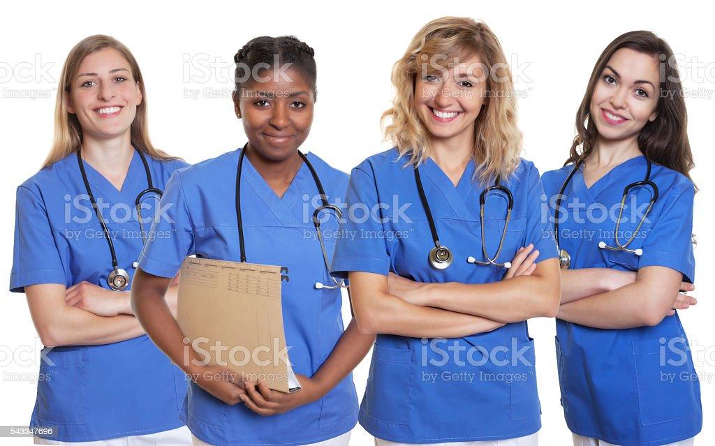 Group of four nurses stock photo