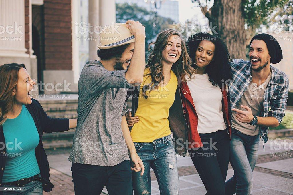 Group of freidns on the street stock photo
