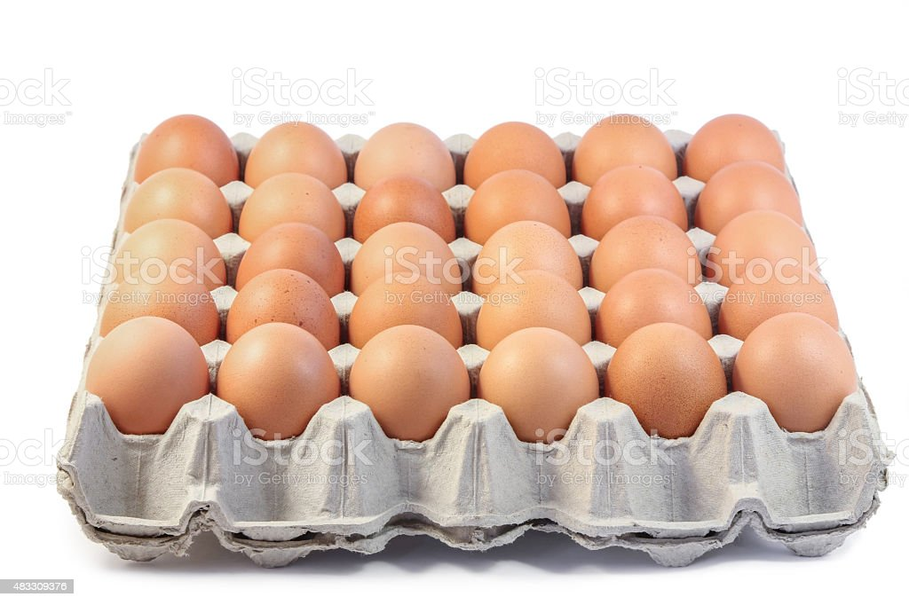 Group of fresh eggs in paper tray on white background. stock photo