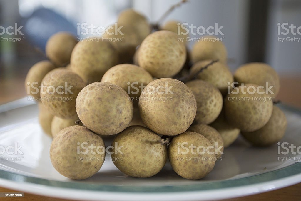 Group of fresh longans on dish. royalty-free stock photo