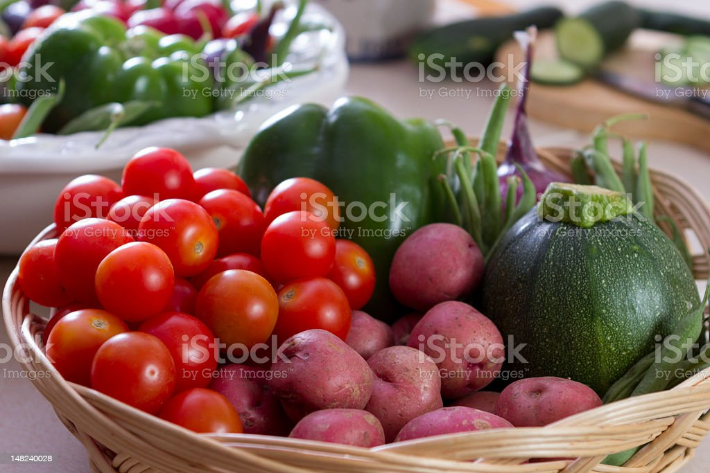 Group of fresh vegetables in a wicker basket. stock photo