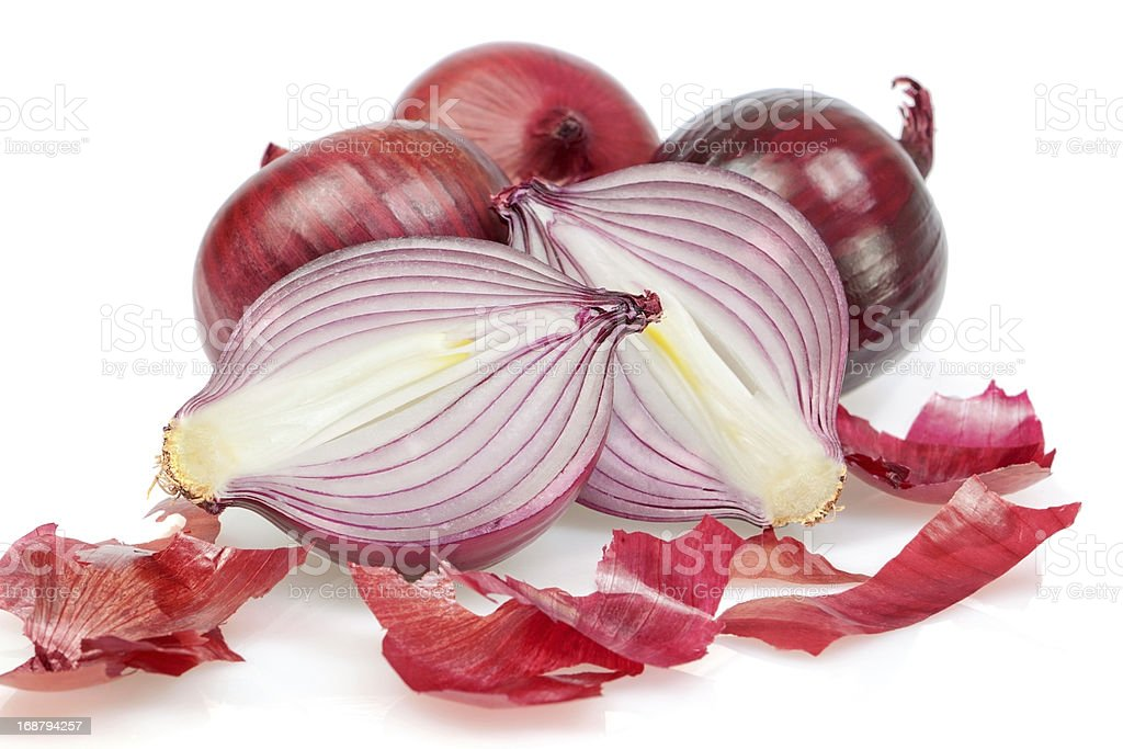 Group of fresh vegetables, onions, unpeeled. On a white backgrou royalty-free stock photo