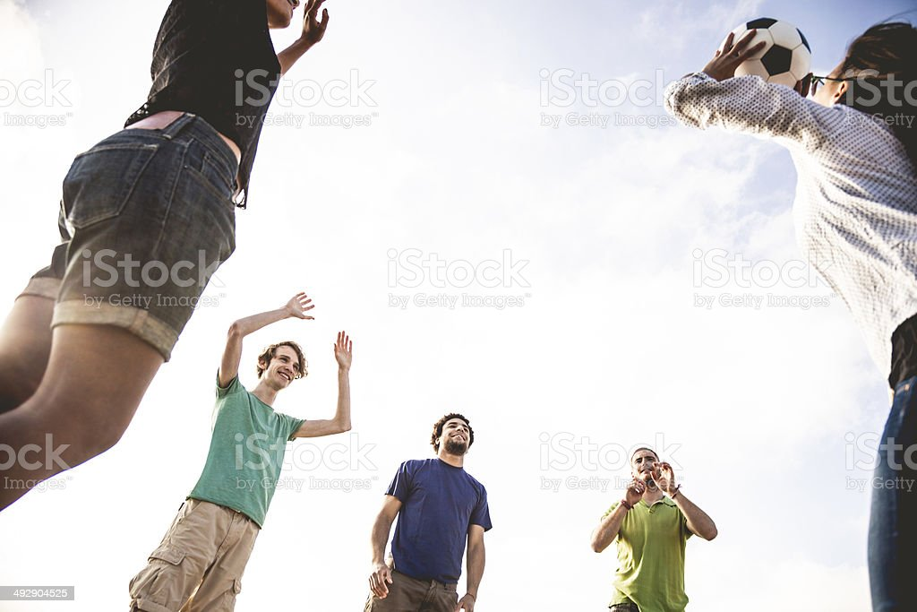 Group of friend play volley on the beach royalty-free stock photo