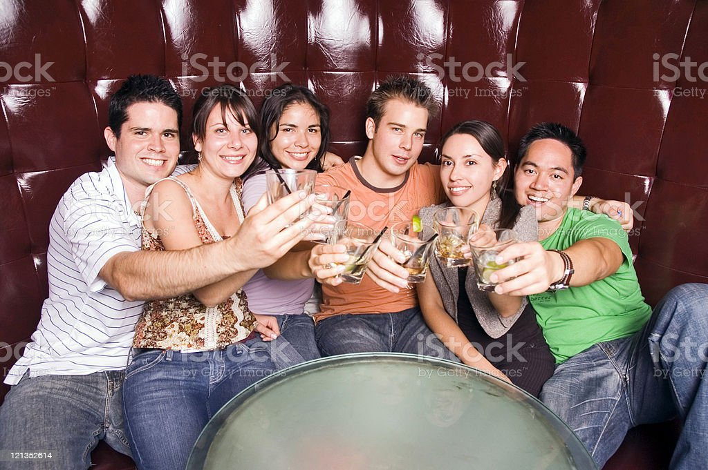 Group of friends at a nightclub royalty-free stock photo
