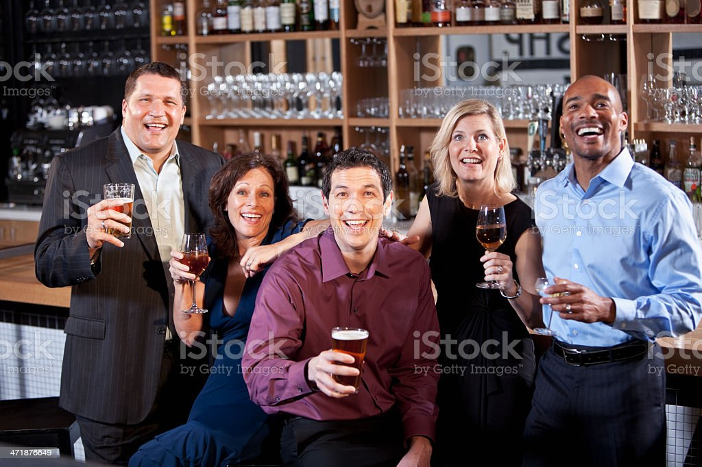 Group of friends at bar royalty-free stock photo