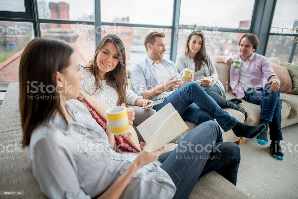 Group of friends at home stock photo