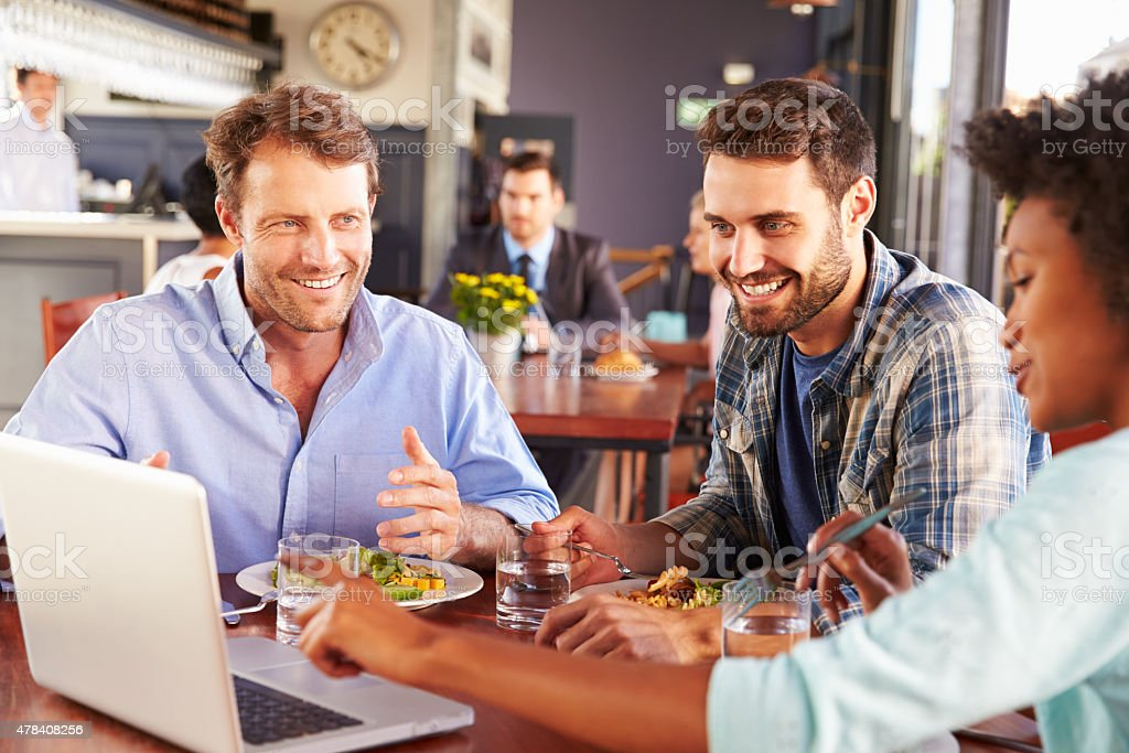 Group of friends at lunch in a restaurant stock photo