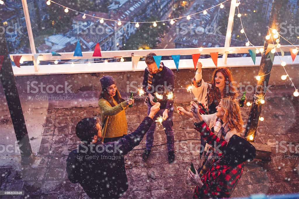 Group of friends at rooftop party stock photo