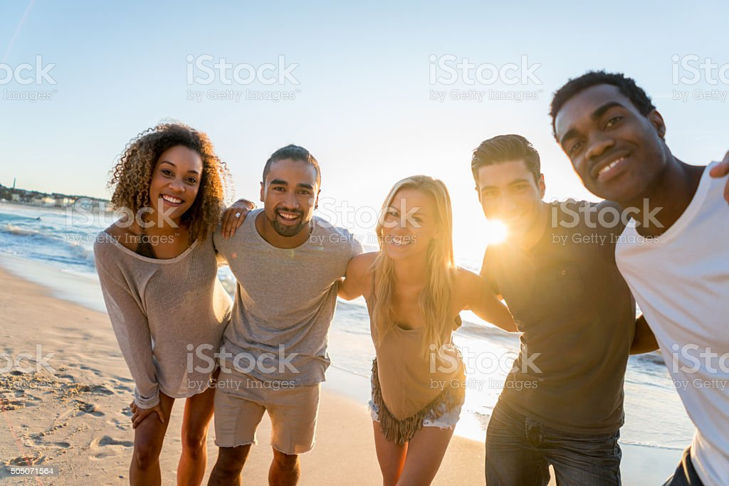 Group of friends at the beach stock photo