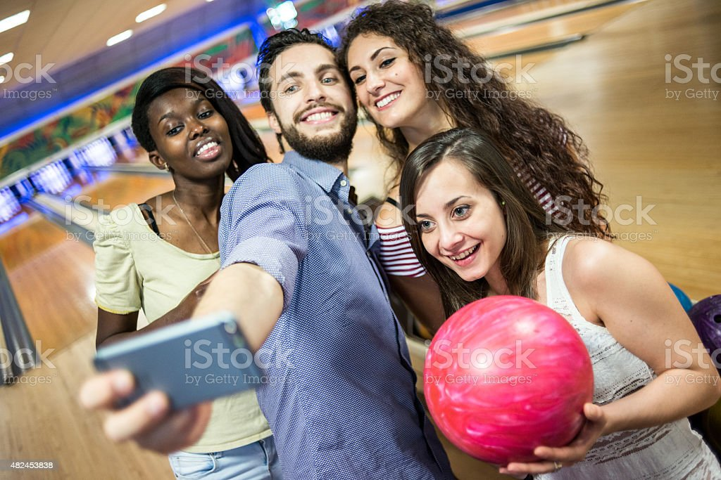 Group of friends at the bowling taking selfie stock photo