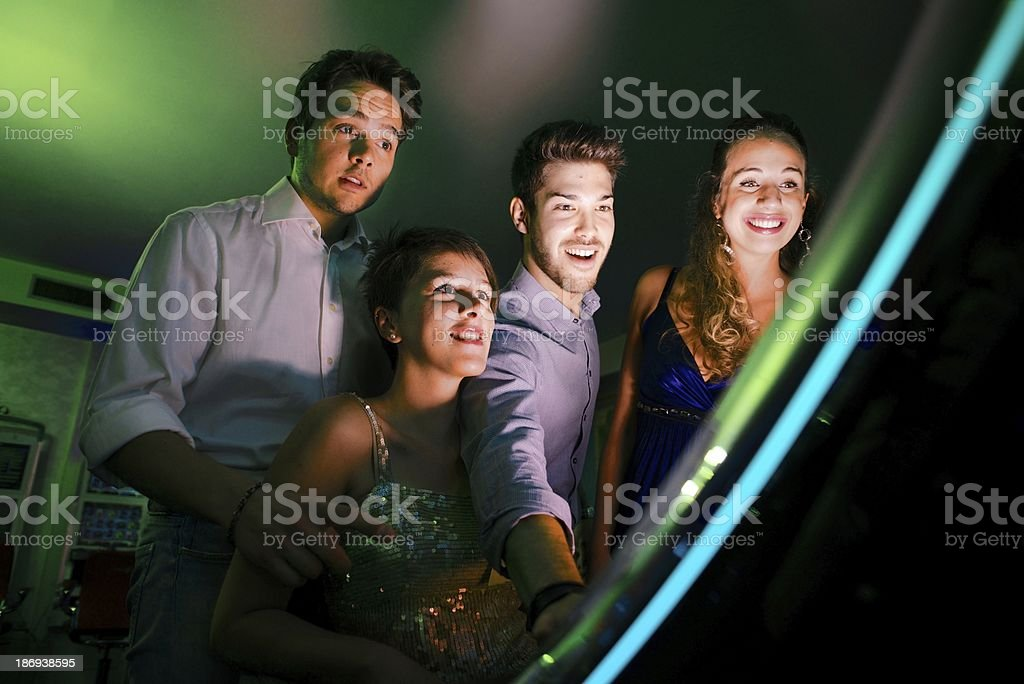 Group of friends at the casino royalty-free stock photo