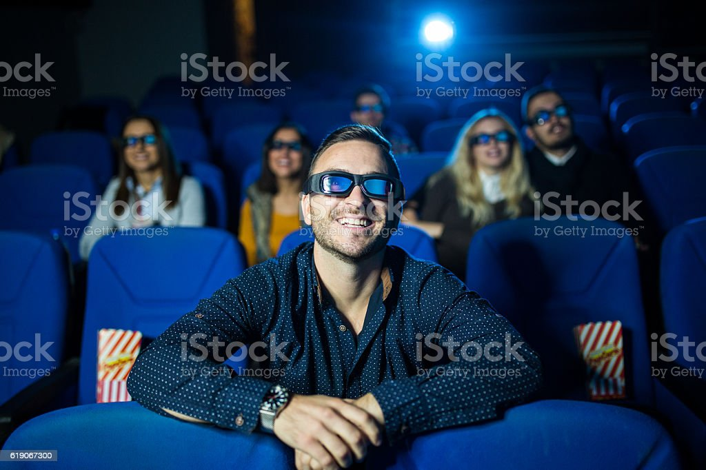Group of friends at the movie theater stock photo