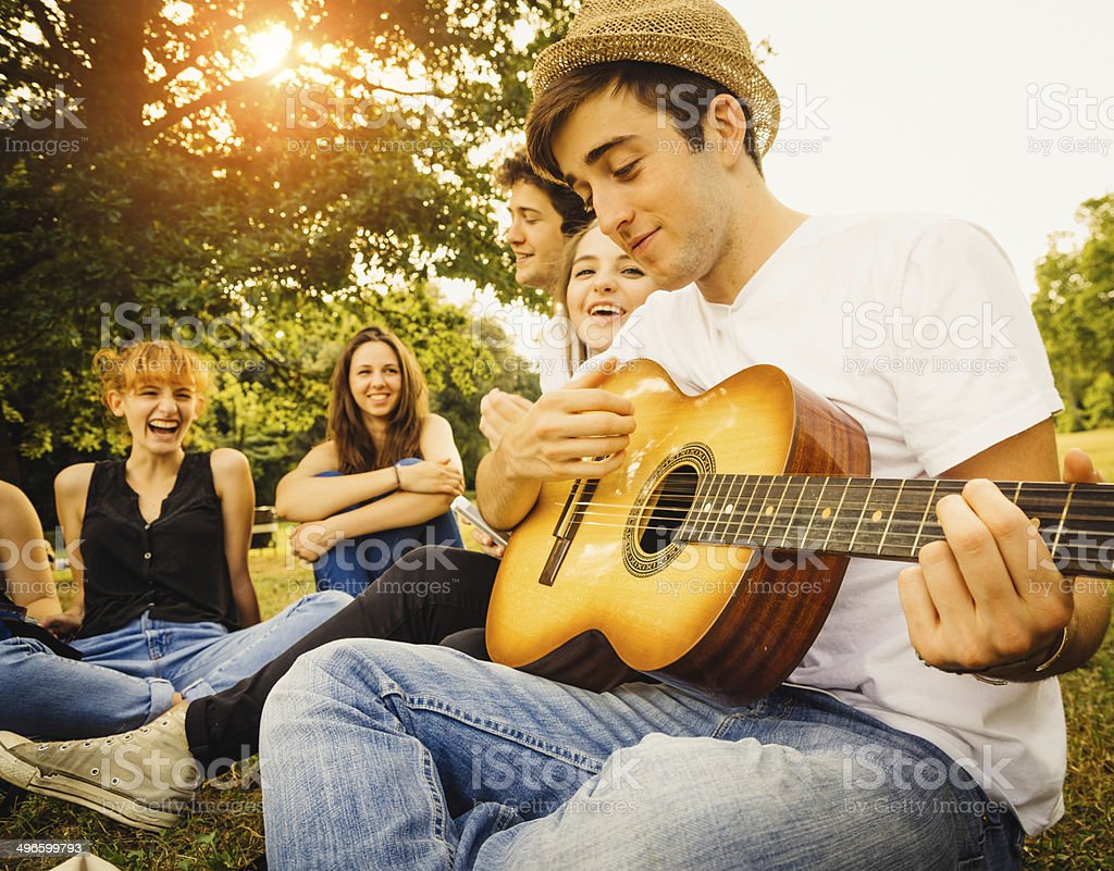 Group of friends at the park together stock photo