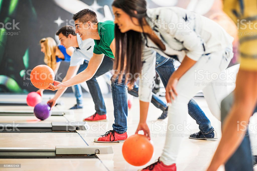 Group of friends bowling. stock photo