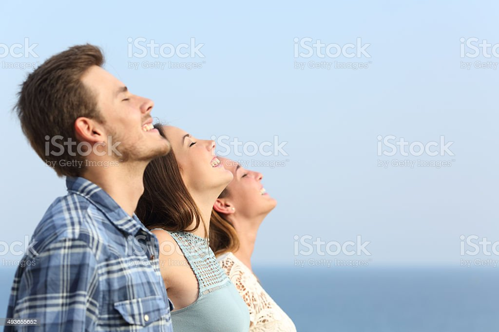 Group of friends breathing deep fresh air stock photo