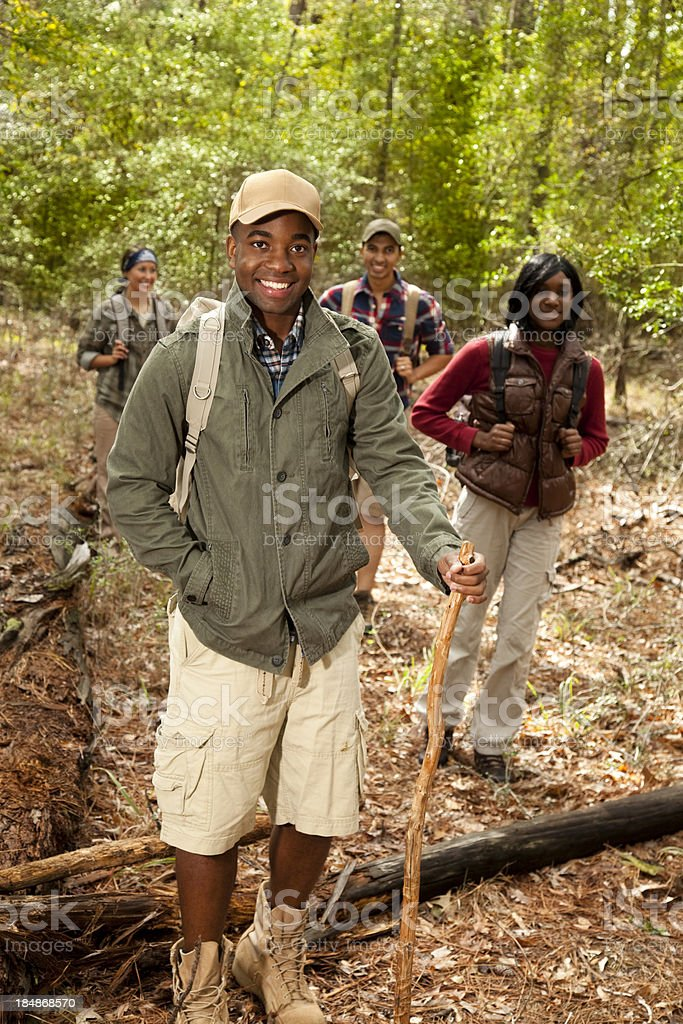 Group of friends camping, hiking in woods, forest. African descent. stock photo