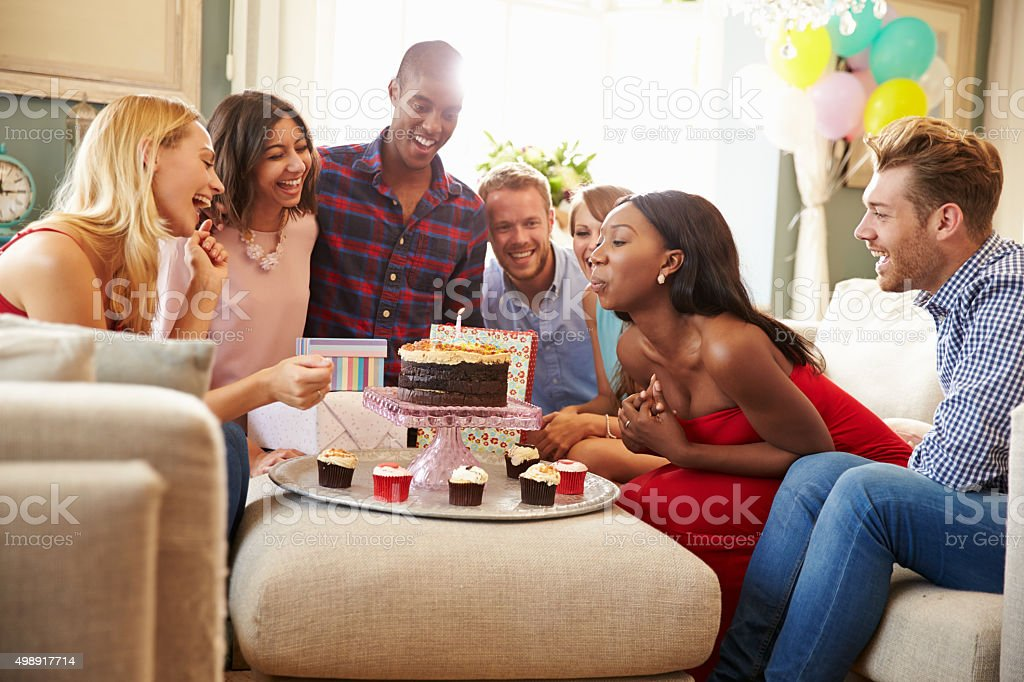 Group Of Friends Celebrating Birthday At Home Together stock photo