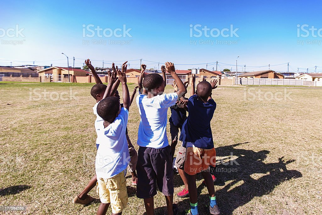 Group of friends cheering up, Gugulethu, Cape Town, South Africa royalty-free stock photo