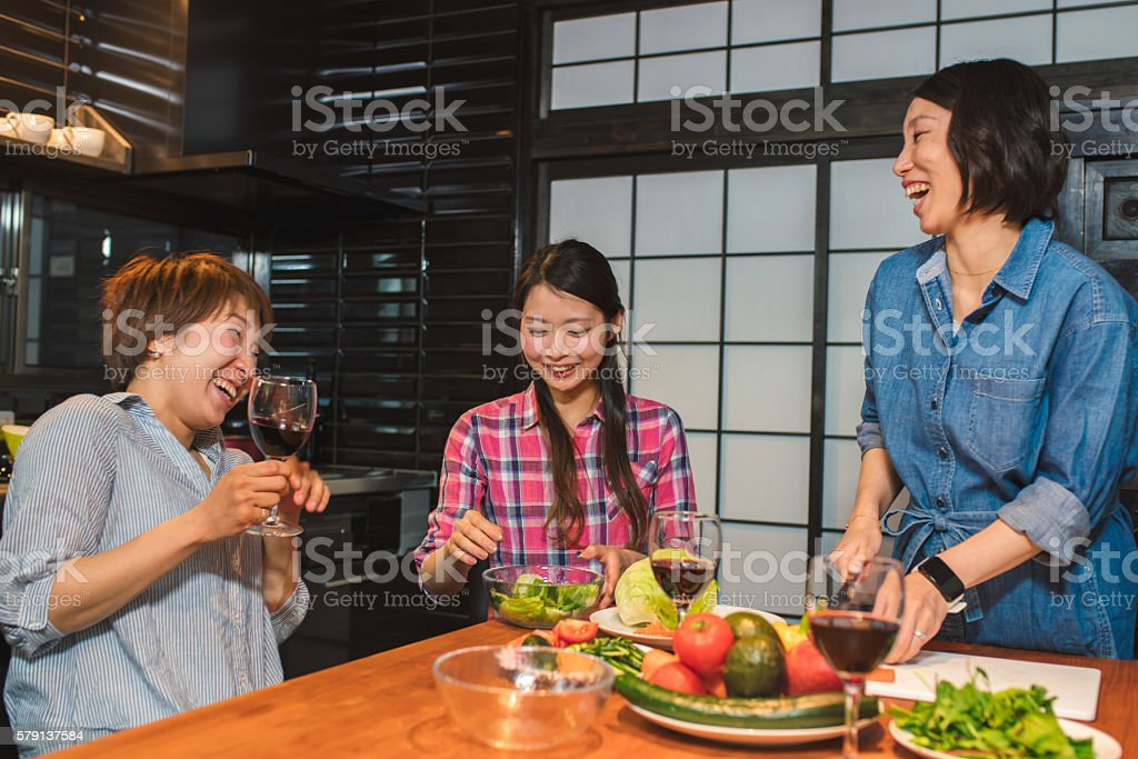 Group of friends cooking together stock photo