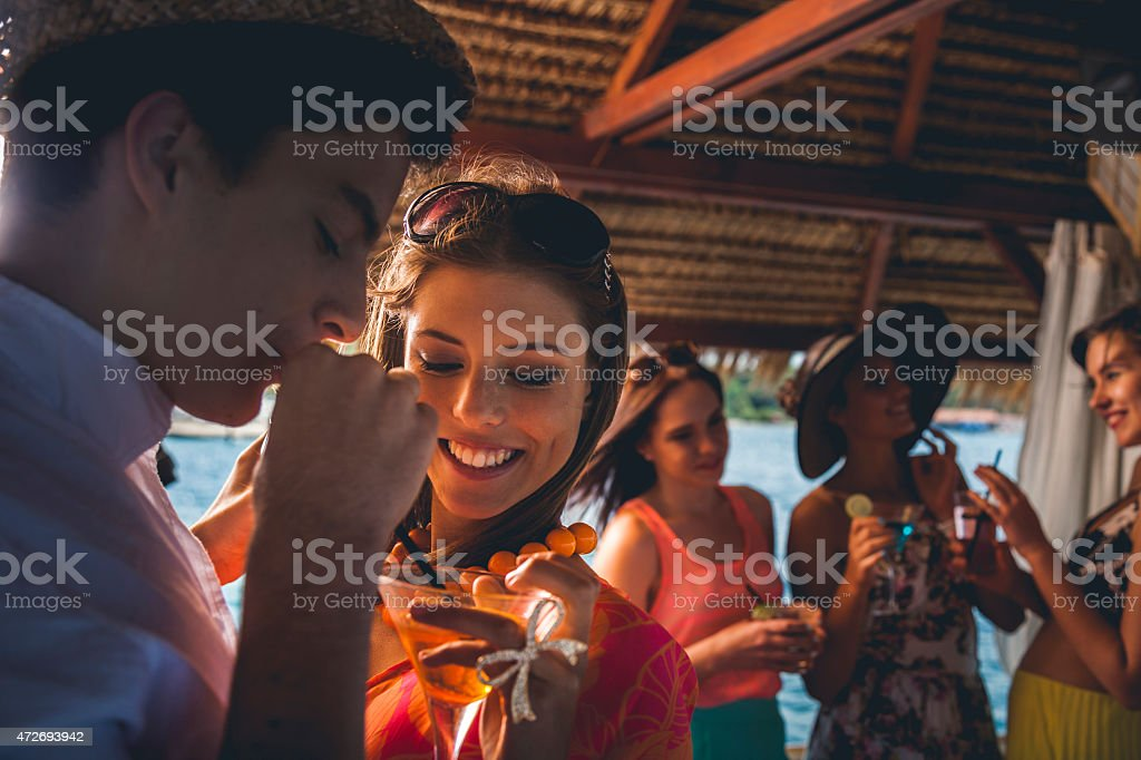 Group of friends dancing during birthday party stock photo