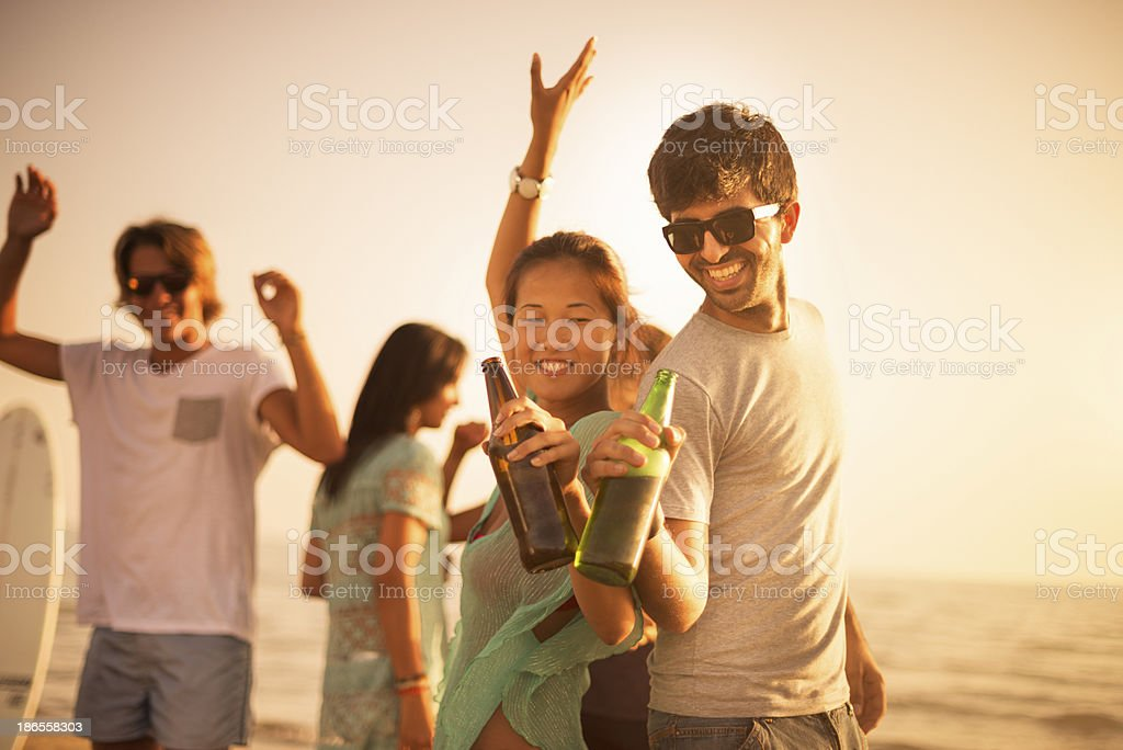 Group of friends dancing on a summer beach party stock photo