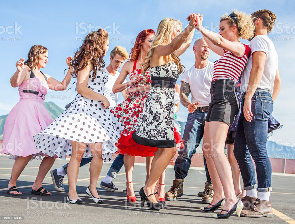 Group of Friends Dancing Outside 1950s Style stock photo