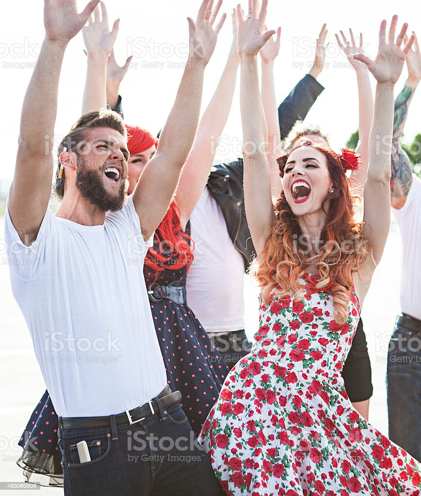 Group of Friends Dancing Outside stock photo