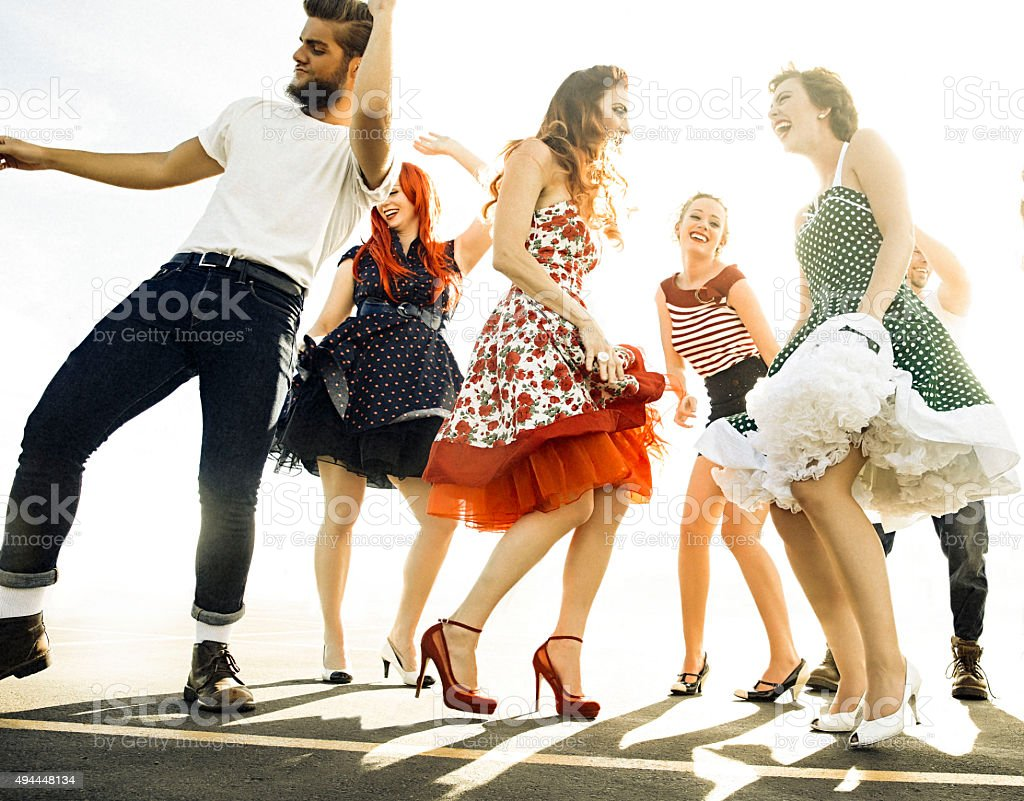 Group of friends dancing. stock photo
