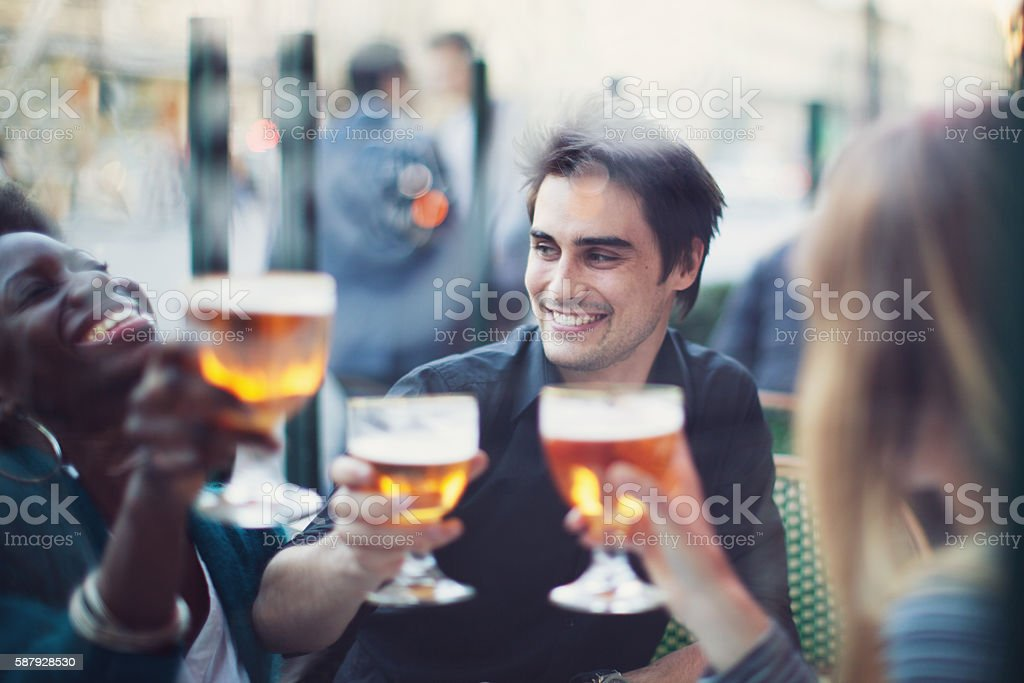 Group of Friends Drinking a Beer stock photo
