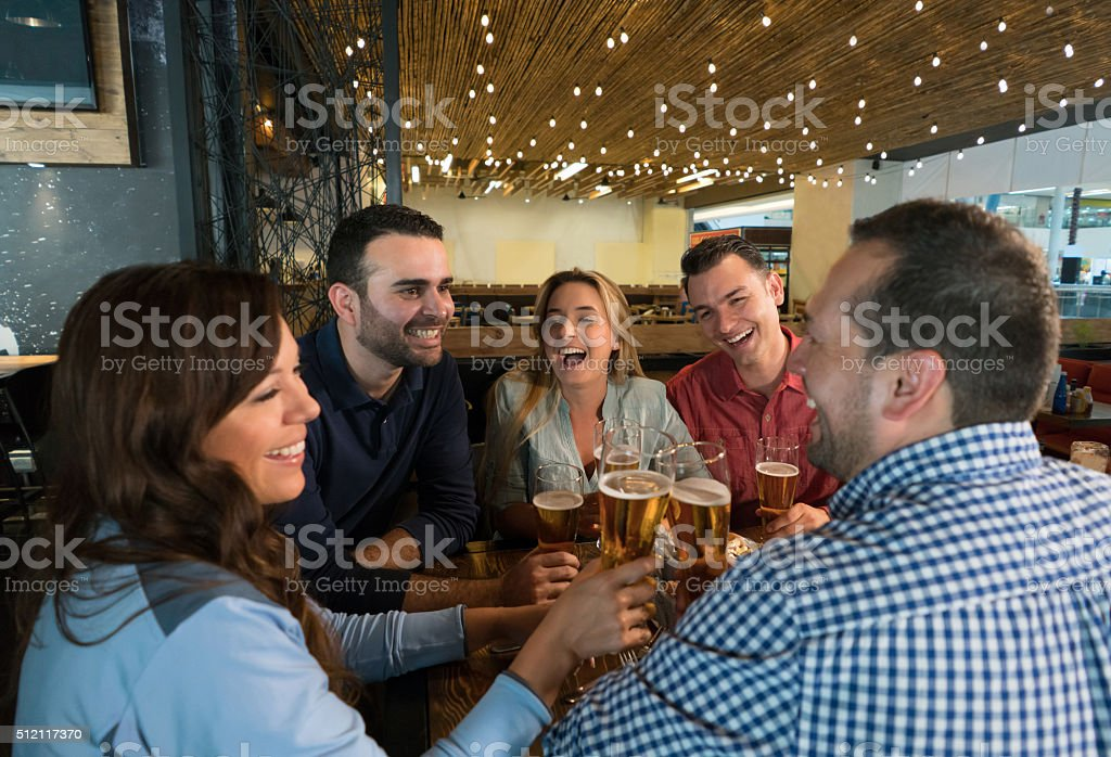 Group of friends drinking at the bar stock photo