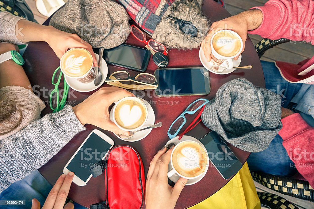 Group of friends drinking cappuccino at coffee bar restaurants stock photo