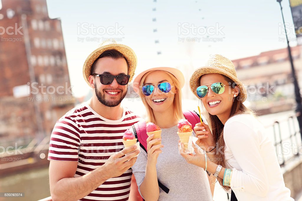 Group of friends eating ice-cream in Gdansk stock photo