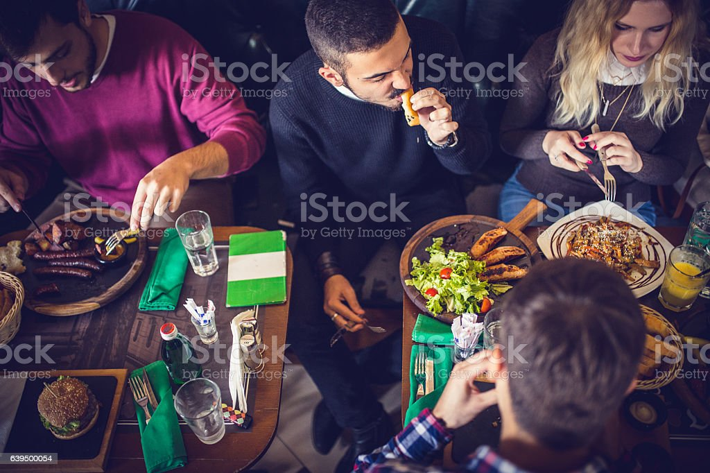 Group of friends eating stock photo