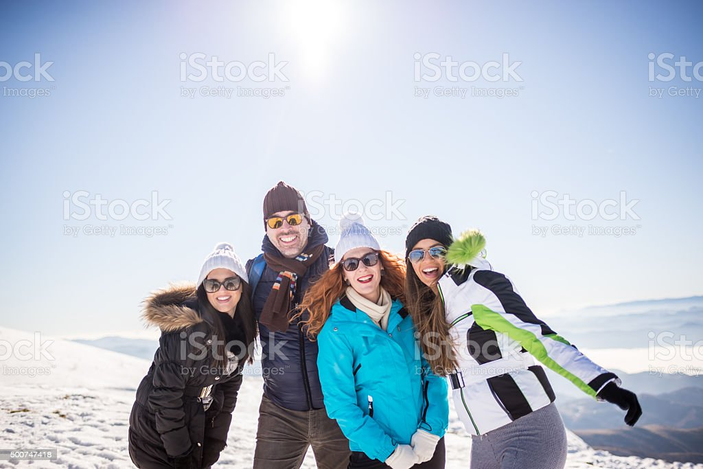 Group of friends enjoy at the top of mountain stock photo