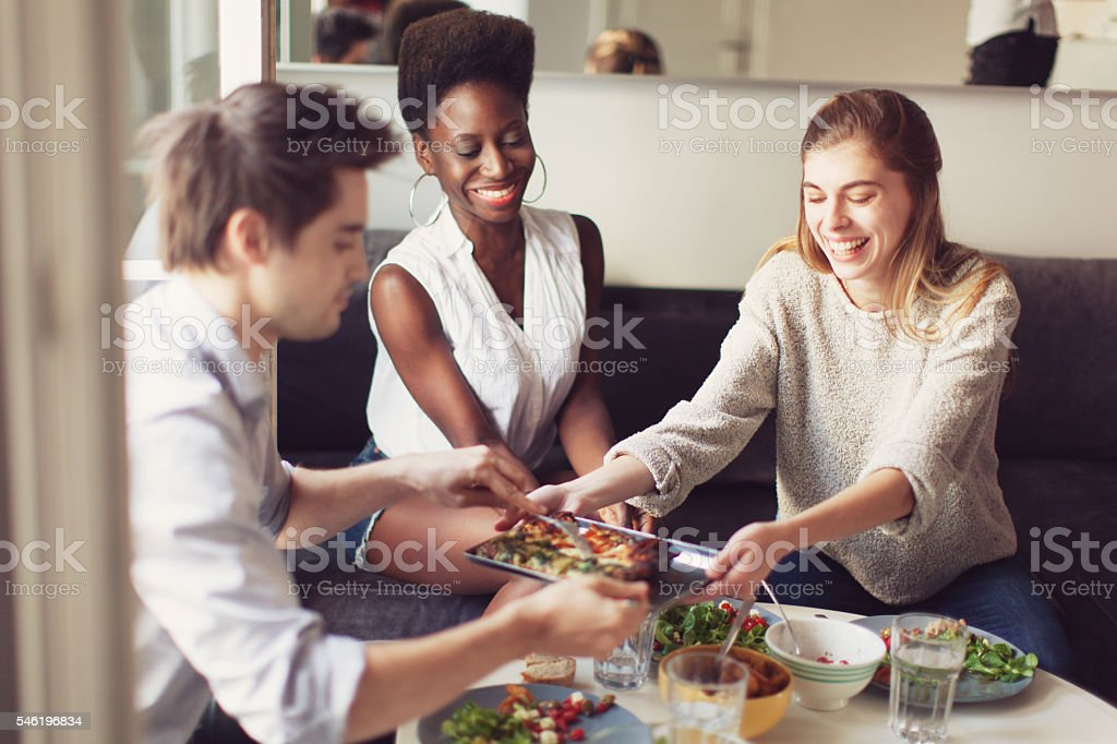 Group of Friends Enjoying a Lunch stock photo