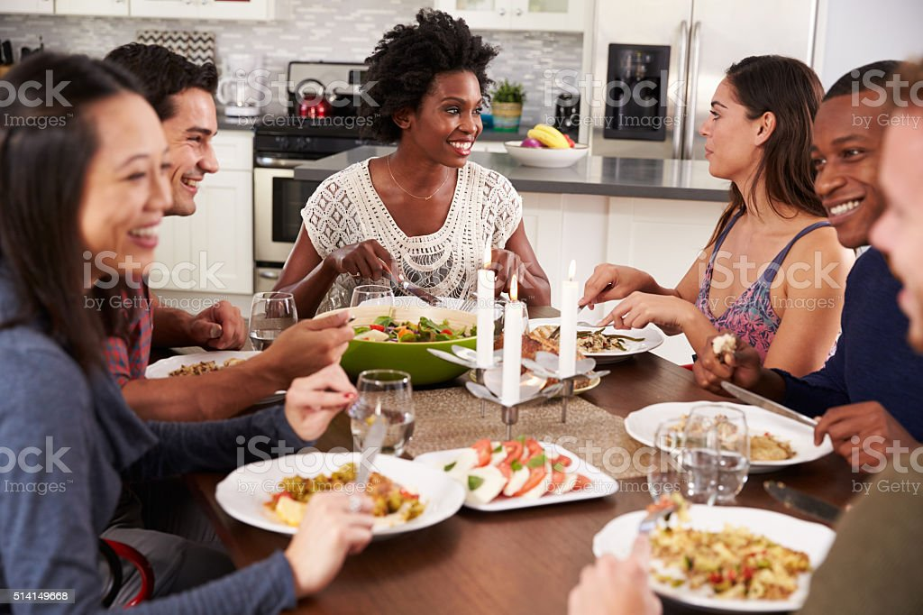 Group Of Friends Enjoying Dinner Party At Home stock photo