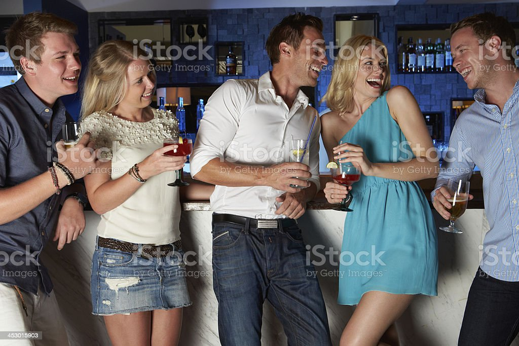 Group Of Friends Enjoying Drink In Bar royalty-free stock photo