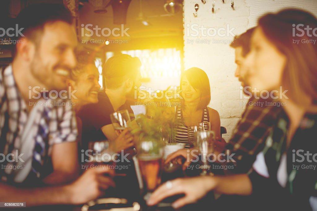 Group Of Friends Enjoying Drink stock photo